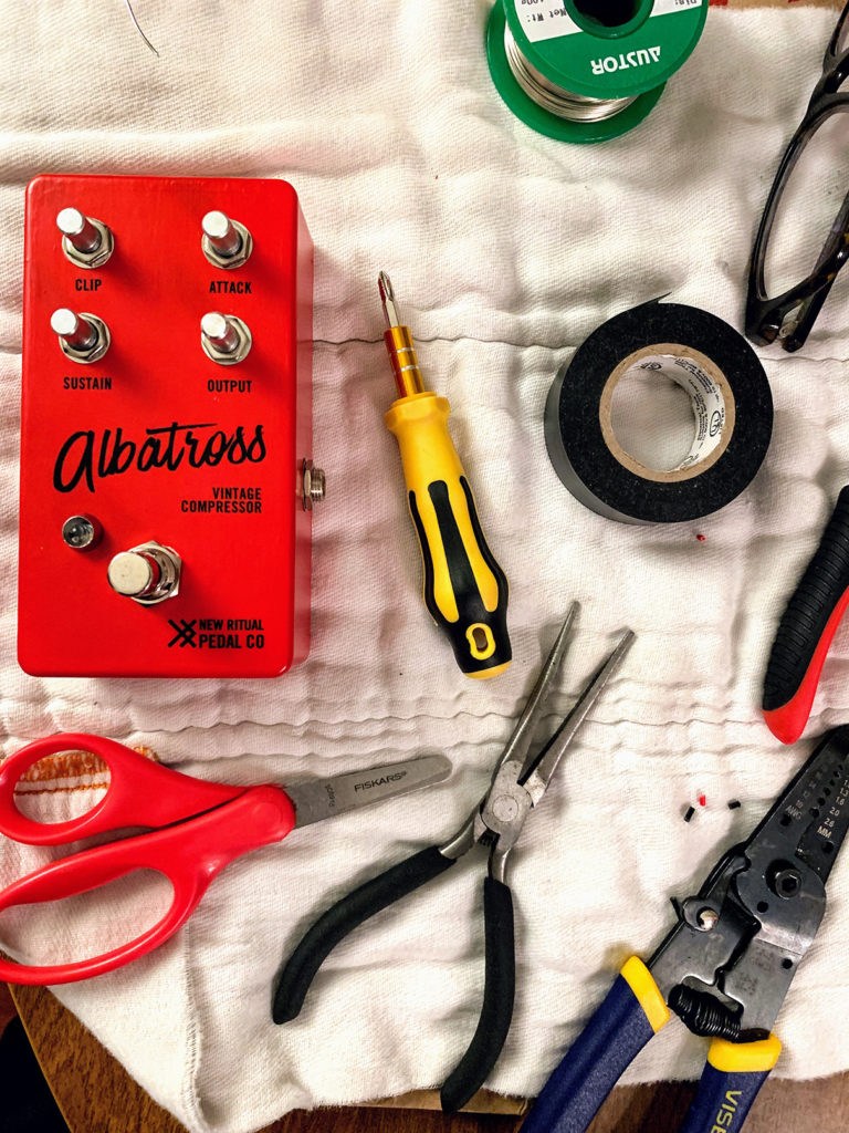 Pedal in progress with soldering tools.